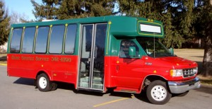 Go to the baggage claim level, outside to the outer island. Take the red/green shuttle van (Boise Shuttle Service) to the Towneplace Suites Downtown. (There is another Towneplace in Meridian)